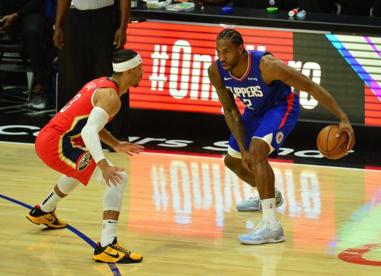 NBA名宿朱利叶斯-欧文在一档节目上谈到了快船前锋科怀-伦纳德
